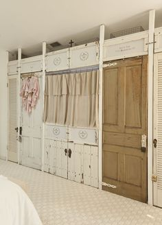 Very shabby closet wall (the flat screen TV is behind the curtains). and old antique doors give a shabby look Build A Wall, Closet Doors, Closet Wall, Closet Storage, Wardrobe Doors, Closet Space, Sliding Wardrobe, Laundry Storage, Door Storage