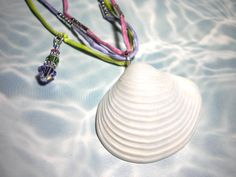 Seashell Necklace on Silk Cords Pink Green Lavender. $22.00, via Etsy.
