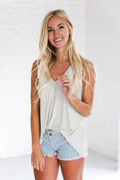 • Taupe v neck loose tank top • Available in sizes S, M, L. Model is wearing a size small • 95% rayon, 5% spandex