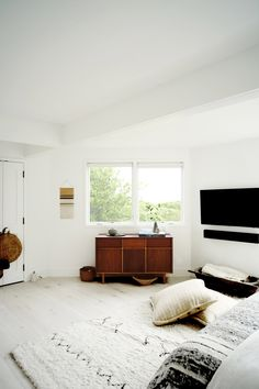 minimalist modern midcentury layers of neutrals; Elisa Restrepo Montauk Beach House Bedroom