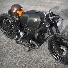 BMW Black Baron >>> Our latest custom motorbike crush is this beastly beamer by Denmark's Relic Motorcycles. The donor bike started as a BMW (it was actually an old police bike) from the and was striped to its essentials. Bmw Cafe Racer, Cafe Racers, Cafe Moto, Bmw Motorcycles, Custom Motorcycles, Custom Bikes, Bmw Scrambler, Bmw Boxer, R65
