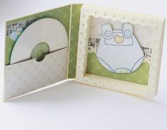 This would make a really cute baby shower gift.  Burn your own CD, and attach blue or pink for a little one...
