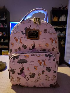 Loungefly Disney Aristocats Backpack on Mercari Disney Handbags, Disney Purse, Disney Inspired Outfits, Disney Style, College Bags For Girls, Book Bags, Striped Pyjamas, Unique Purses, Aristocats