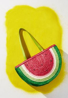 One outing with this ultra-cute straw handbag and you'll find the 'slice' is right! 'Seeding' the way in bright fashion with its watermelon shape, red and green hues, and sturdy, structured bottom, this statement purse is one you'll want to tote everywhere. Talk about fruitful!