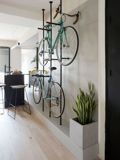 Bespoke storage creates room for bicycles in renovated Barcelona flat Colombo and Serboli Architecture has revamped a Barcelona apartment, opening up the partitions to create a large living space with a bespoke, wall-mounted bicycle rack.