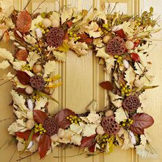 Use muted colors and natural elements to decorate your fall front entry with a classic and easy-to-achieve look. Accent your front door with a store-bought square magnolia wreath and embellish with twigs, seedpods, nuts, berries, wheat, and leaves, securing them to the wreath using florists wire./