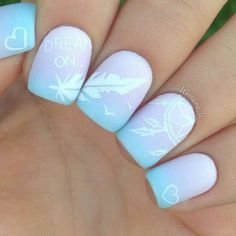 Light gradient feather nail art. Create a light gradient on your nails in baby blue and periwinkle hues. Add the feather details in white polish to give that clean and tidy look.