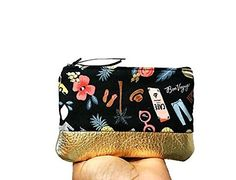 "Bon Voyage Black Small Leather Pouch, Coin Purse, Metallic Gold Change Wallet, Zipper Pouch, Coin Pouch. Stash all of your small essential items in this cute black small leather pouch. Crafted with cotton fabric and soft metallic gold leather, this coin purse is a chic and fashionable way to hold your coins, cash and credit cards. Features: 100% cotton printed fabric, 100% cotton lining, gold leather, and 6"" zipper closure. Dimensions: 4 Tall X 6 Wide . Care Instructions: Spot clean only...."