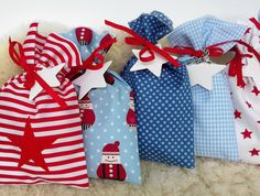Bald ist Advent und die Adventsvorbereitungen beginnen? Hier findet ihr einen schönen Adventskalender in blau und rot, aus Baumwolle gefertigt. **!!! NEU IM SHOP !!!** Ihr wollt die **Sterne...