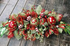 Christmas Deco Mesh Centerpiece by WreathsEtc on Etsy. , via Etsy.