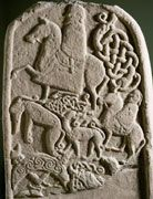 The busy reverse of stone number 4 at Meigle includes a Pictish beast with a crescent and V-rod on the left