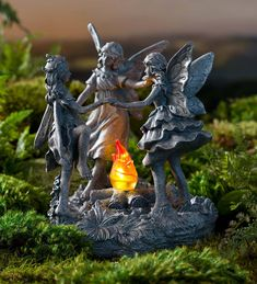 Add a group of jubilant fairies to your garden with our charming Dancing Fairies with Solar Fire sculpture. This trio of fairies in flowing summer dresses is in the mood for a dance as they gather around their roaring fire. Solar-powered LEDs create a glow within the flames so their dance can continue into the night. This charming and detailed sculpture is cast in resin for indoor or outdoor display. Wind & Weather Exclusive Design.