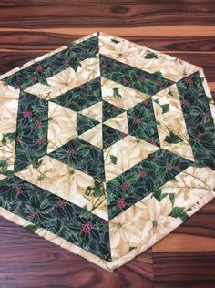 Metallic Christmas Centerpiece Quilted Table Topper Gold Outlined Fabric Homemade Quilt Hexagon End Table by Heathersquaintquilts on Etsy https://www.etsy.com/listing/451830986/metallic-christmas-centerpiece-quilted