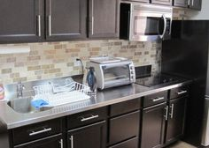 Stainless steel countertops and dark wood