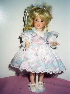 Handmade Porcelain Doll  Hilary. $45.00, via Etsy.