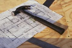 1568 x 1056; Detail shot of hammer, blueprint, and carpenter square. (Building on Faith 1995)  (Habitat World, De