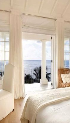 love those tall, white curtains...notice how they're placed several inches above the window - helps to make the room appear bigger!
