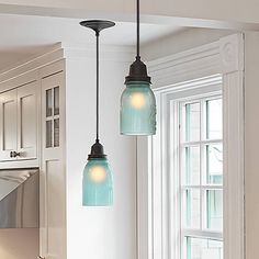 Kitchen pendant lights made from frosted-blue-glass mason jars. What's not to love?    Photo: Susan Teare   thisoldhouse.com