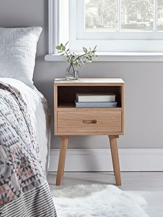 Carefully handcrafted from sustainable and responsible oak, our fabulous oak bedside table has a smooth, unfinished top and visible wood grain details, making each piece completely unique.  With an open shelf and single drawer, it's perfect for storing your bedside essentials.