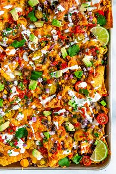 Loaded Vegetarian Sheet Pan Nachos - No superbowl sunday is complete without these crowd pleasing nachos that are done in just 20 minutes! Veggie Nachos, Vegetarian Nachos, Vegetarian Mexican Appetizers, Mexican Snacks, Mexican Food Recipes, Nacho Recipes, Veggie Recipes, Vegetarian Recipes, Cooking Recipes