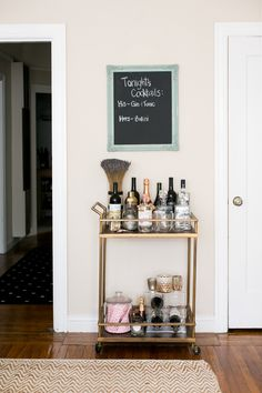 I've been thinking about styling for my bar cart... this is a great one.  #bar, #entryway, #bar-cart  Photography: Monica Wang - www.monicawangphotography.com  Read More: http://www.stylemepretty.com/living/2014/07/07/behind-the-blog-with-gal-meets-glam/
