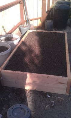 how to make a raised bed. I like what they layer in the bottom of this bed for soil feeding