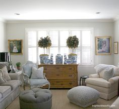 Tv room idea with the 2 chairs on either side of window! Holiday Home Tour - Terri Milikin - Holiday Decorating Blogs