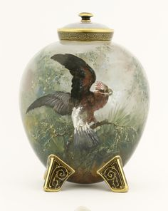 A Minton pottery Vase and Cover, dated 1871, painted by William Mussil, with a parrot on a branch, the reverse with irises, raised on four lug feet Sold for £800 on 15th September 2015