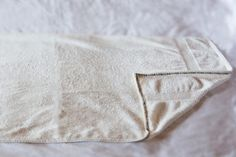 Are you tired of bath towels slipping down as you get ready? The answer is a bath towel wrap. They are moderately easy and inexpensive to make at home. You
