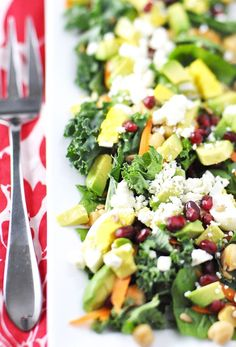 baby spinach and kale salad with avocado, chickpeas, and feta