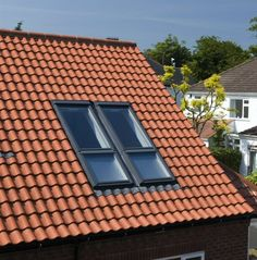 Clay Roof Tiles with Skylights #ExteriorMedics #HomeImprovement