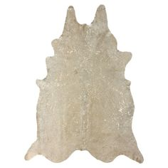 Add a rustic-chic touch to your living room or den with this handcrafted cowhide rug, showcasing a flecked motif in an eye-catching metallic palette.