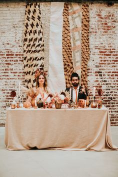 Boho couple at sweetheart table with fun florals at The Crossroads Hotel in Kansas City, MO for Bold & Boujee Styled Shoot Florals by: The Cottage Rose Photo by: The Bold Americana Boho Bride, Boho Wedding, Floral Wedding, Wedding Reception Photography, Kansas City Wedding, Photography Workshops, Industrial Wedding, Couple Portraits, Wedding Vendors