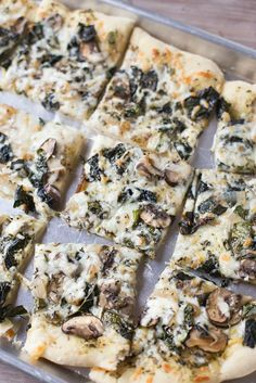 Save money by making your own homemade veggie pizza. Loaded with kale, mushrooms and basil pesto!