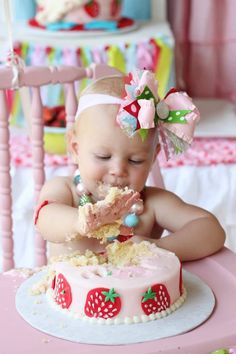 Strawberry Smash cake.  Note the cute headband and necklace - no shirt to help with the mess!  Love it.