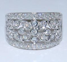 14K White Gold Diamond WIDE Flower Anniversary Band Wedding Ring. $689.00, via Etsy.
