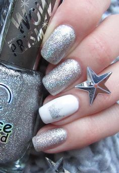 Shiny silver color is tamed with one nail in white with small silver crown on it. If you want you can one more nail on the hand to paint in the monotonous white, and thus tame the playful silver color.