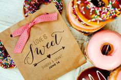 Cute (+ delish) favor idea:  donuts in these 'Love is Sweet' kraft bags! By Mavora.   http://emmalinebride.com/favors/kraft-paper-favor-bags-love-is-sweet/
