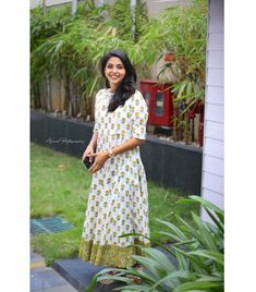 The charismatic actress Aishwarya Lekshmi wears our Ivory and yellow block-printed ankle-length dress. Her minimalistic style statement paired with a 24 carat smile makes her look absolutely gorgeous! Western Dresses, Indian Dresses, Indian Outfits, Simple Dresses, Casual Dresses, Fancy Sarees Party Wear, Simple Kurta Designs, Set Saree, Frock Fashion