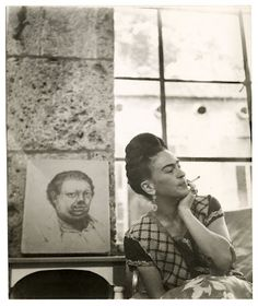 Lola Alvarez Bravo, Frida Kahlo with 1930 Self-Portrait drawing by Diego Rivera, Coyoacan, circa 1945. Vicente Wolf Photography Collection. Lola Alvarez Bravo © 1995 Center for Creative Photography, The University of Arizona Foundation.
