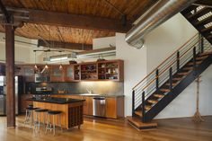 Industrial design style is often found in lofts or other reclaimed industrial spaces. Open spaces, high ceilings, and floor-to-ceiling windows are common in industrial spaces and defining decorative elements. Industrial spaces show their building materials as a design element, by using exposed brick walls, concrete or weathered wood floors, bare ceilings, structural beams, and metal air ducts.