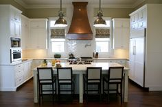 these cabinets are the same color & style as mine - notice the rich wall color - does my kitchen need darker walls??