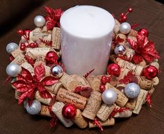 12`centrepiece, holds 4`candle. All corks different. Ornaments are red, silver and white. Poinsettias are glittery red. $85