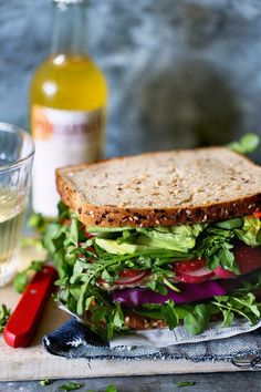 """Ultimate Veggie Sandwich: """"Ultimate"""" may be an understatement for this wonder from Bakers Royale. This feast of roasted red pepper spread, butter leaf lettuce, red cabbage, grilled tempeh and other yumminess comes sandwiched between slices of eureka! Seeds the Day Organic Bread."""