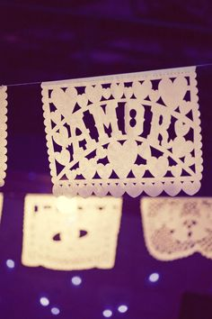 #papel-picado  Photography: The Nichols - www.jnicholsphoto.com Wedding Coordination: The Simplifiers - www.thesimplifiers.com  Read More: http://www.stylemepretty.com/2011/06/06/austin-wedding-by-the-nichols-3/
