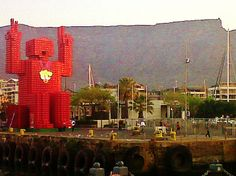 The Coca Cola man with Table Mountain as a backdrop at Cape Town's V&A Waterfront. V&a Waterfront, Table Mountain, Holiday Accommodation, Tour Operator, African Safari, Cape Town, Continents, Coca Cola, Backdrops