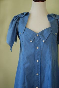 This RECONSTRUCTED mens button up, is adorable paired with some tights or even jeans. Square neck line, Pleats just below bust, allow for drama to the structure and flow to the fit. Tunic style bodice, fits for loose around waist, top is best on smaller chest sizes. Elastic band detail