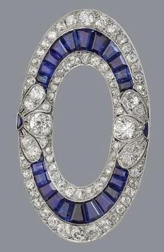 A sapphire and diamond brooch, circa 1915 The openwork ellipse set with calibré-cut sapphires, old brilliant and rose-cut diamonds, with additional pierced foliate decoration millegrain-set with similarly cut diamonds and crescent-shaped sapphires, diamonds approximately 3.40 carats total, width 5.3cm., cased by Hennell, Southampton St, London by LiveLoveLaughMyLife