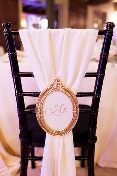 Wedding chair decor idea. Vintage frame with Mr. written in the center.