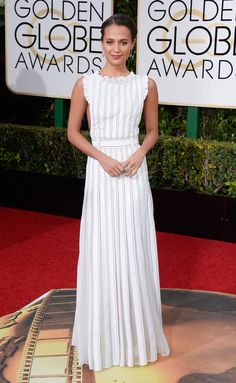 Alicia Vikander stunned in a mousseline, open-back dress by Louis Vuitton, teamed with shoes and jewelry by the French fashion house. See more of the Golden Globes' best dressed stars here!